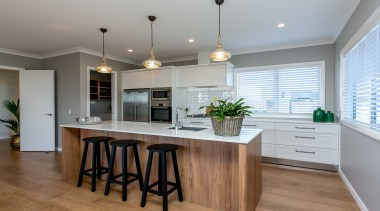 A lovely open plan kitchen with scullery features cabinetry, countertop, cuisine classique, interior design, kitchen, real estate, room, gray