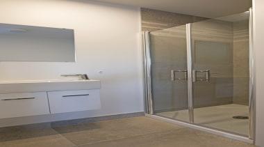 Custom made to fit the shower exactly, the bathroom, floor, interior design, plumbing fixture, room, gray, brown
