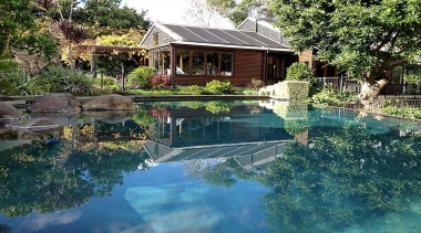 Gold Award recipient for Refurbished or Renovated Residential backyard, cottage, estate, home, house, landscape, leisure, nature, outdoor structure, plant, pond, property, real estate, reflection, resort, swimming pool, tree, water, teal