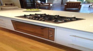 Metricon Homes lifestyle property  in Australia fitted countertop, floor, flooring, furniture, hardwood, kitchen, kitchen appliance, kitchen stove, orange