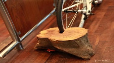 Sustainable bicycle storage solution. So simple but such flooring, musical instrument, wood, brown, red