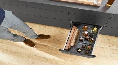 AMBIA-LINE inner dividing system – organization at its floor, flooring, furniture, hardwood, laminate flooring, product design, table, wood, wood flooring, wood stain, orange, black