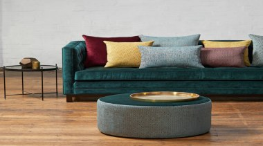 Soft, plush and inviting, this dynamic collection is chair, coffee table, couch, floor, flooring, furniture, interior design, living room, studio couch, table, white