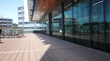 This large beautiful staff decking facility was build apartment, architecture, building, condominium, corporate headquarters, daylighting, facade, glass, metropolitan area, mixed use, reflection, structure, walkway, window, black, white