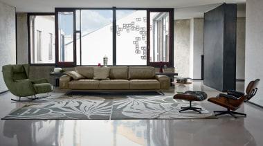 PRIANERA Bernini - PRIANERA Bernini - angle | angle, chair, couch, floor, flooring, furniture, interior design, living room, loveseat, room, table, window, gray