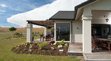 Multiple outdoor spaces in this home built by cottage, home, house, outdoor structure, property, real estate, brown