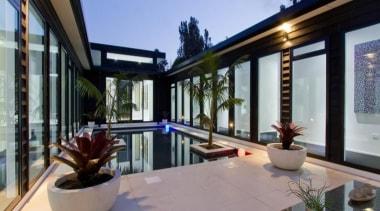 A contemporary house design by Design House Architecture apartment, architecture, estate, home, house, interior design, property, real estate, swimming pool, villa, window, gray, black