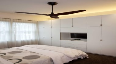 A bank of cabinets stops short of the bed frame, bedroom, ceiling, home, interior design, light fixture, lighting, room, wall, gray