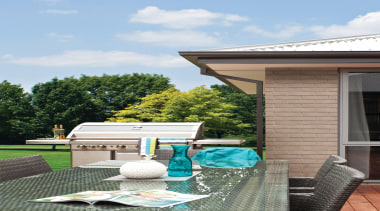 This unique range captures the essence of modern backyard, home, house, outdoor structure, property, real estate, roof, yard, gray