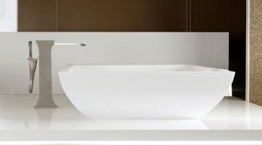 The Mimi floor-mount tub filler makes a vivid angle, bathroom, bathroom sink, bidet, ceramic, plumbing fixture, product design, sink, tap, toilet seat, white
