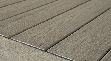 The owner of this Canterbury home chose to angle, floor, line, plank, plywood, texture, wood, wood stain, gray