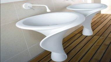 Resembling the shape of the Calla lilly, the bathroom sink, ceramic, plumbing fixture, product, product design, sink, tap, toilet, toilet seat, gray, white