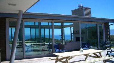 Amodea Bay - door | outdoor structure | door, outdoor structure, property, real estate, roof, window, teal, black