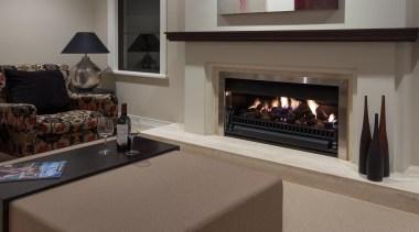Mellons Bay 13 - fireplace   floor   fireplace, floor, flooring, hearth, interior design, living room, wood burning stove, gray, black