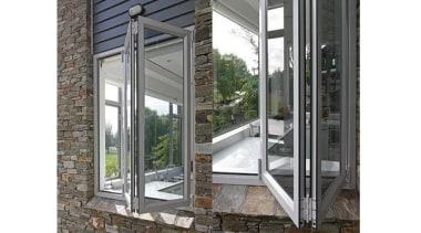 Windowmakers bi-fold windows run on an easy-slide track door, glass, porch, window, white, gray