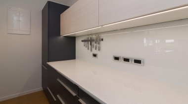 Lighting sunken into the edge of the top cabinetry, countertop, floor, home, interior design, kitchen, property, real estate, room, gray