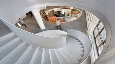 The design for renowned advertising agency Wieden+Kennedy moves architecture, daylighting, product design, stairs, gray