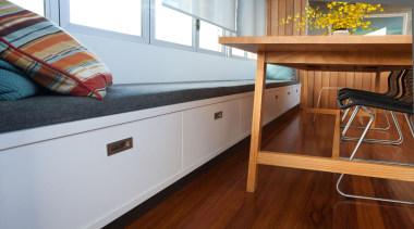 Storage drawers are built into the new window floor, flooring, furniture, hardwood, laminate flooring, room, table, wood, wood flooring, wood stain, gray, brown