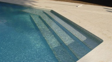 Pool coping area. - RAK Stone Range - daylighting, floor, line, road surface, roof, swimming pool, wood, teal, orange