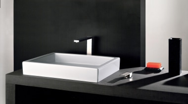 With its iconic rectangular shape, the Rettangolo collection bathroom, bathroom sink, plumbing fixture, product, product design, sink, tap, black, white