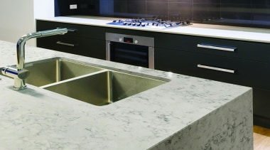 Helix balances its off-white base color with carefully countertop, floor, kitchen, sink, white, black, gray