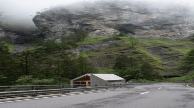 The visitor centre located at the top of alps, cloud, geological phenomenon, highland, highway, hill, hill station, infrastructure, lane, mountain, mountain pass, mountain range, mountainous landforms, plant, road, sky, tree, winter, gray, brown
