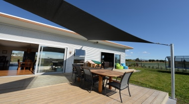 Deck in rural settingHome built by Fowler Homes awning, canopy, house, outdoor structure, real estate, roof