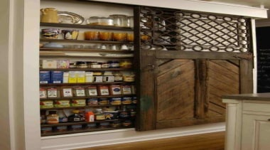Very cool way of hiding stuff and covering bookcase, cabinetry, furniture, kitchen organizer, pantry, shelf, shelving, brown, gray