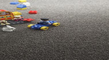 Heaps of carpets - asphalt | toy | asphalt, toy, yellow, gray, black