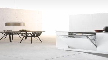 Miele appliances feature in this modern and simplistic chair, coffee table, floor, flooring, furniture, interior design, product design, table, white