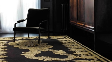 This dramatic design was originally conceived for an carpet, chair, floor, flooring, furniture, hardwood, interior design, table, wood flooring, black