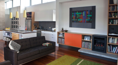 The new cabinetry uses a restained pallet of bookcase, furniture, interior design, living room, room, shelving, gray, black