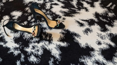 The Pony rug captures Alexander McQueen's skill at shoe, water, black