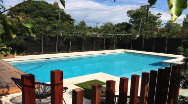 Gold Award recipient for Residential Swimming Pools over backyard, estate, home, house, leisure, outdoor structure, property, real estate, resort, swimming pool, villa, water, black