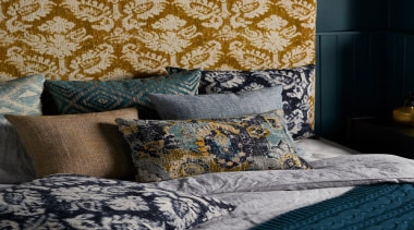 Persian influences and modern interpretations of textured weaves, bed, bed sheet, bedding, bedroom, blue, cushion, duvet cover, furniture, interior design, linens, pattern, pillow, room, textile, wall, black, gray