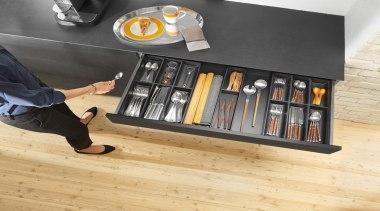 AMBIA-LINE inner dividing system – organization at its floor, flooring, furniture, product, product design, shelf, shelving, table, wood, orange, black