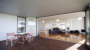 Great indoor /outdoor flow in this home built apartment, ceiling, floor, flooring, house, interior design, living room, property, real estate, room, window, wood, wood flooring, gray