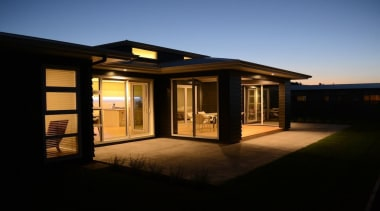 Stylishly practical outdoor/indoor loggia is a feature of estate, evening, facade, home, house, lighting, property, real estate, residential area, shed, sky, window, black
