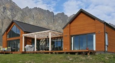 Landmark Homes Design & Build - Landmark Homes cottage, elevation, facade, farmhouse, home, house, hut, landscape, log cabin, real estate, roof, siding, wood, brown, gray