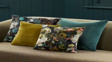 Flowerbomb features a majestic, ethereal bouquet of peonies, cushion, furniture, pillow, textile, throw pillow, black, brown