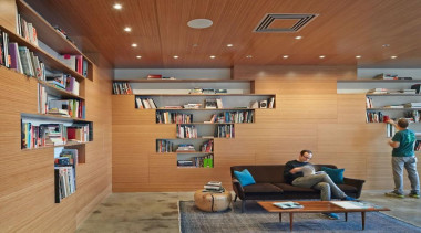 The design for renowned advertising agency Wieden+Kennedy moves ceiling, institution, interior design, library, lobby, public library, wood, brown