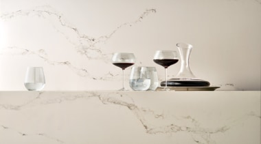 Caesarstone's interpretation of Statuario marble; Statuario Nuvo brings furniture, interior design, lighting accessory, product design, still life photography, table, tap, white