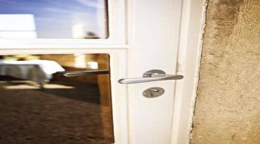 1935, Solid Lever Handle on rose. Satin Nickel door, window, white