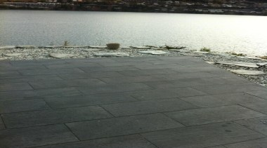 Stone D graphite exterior patio floor tiles - floor, road surface, sky, walkway, wall, water, gray, black