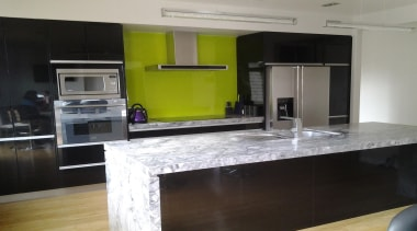 Standard Colour-backed Glass. Splashback situated behind stove top, cabinetry, countertop, interior design, kitchen, room, black, gray