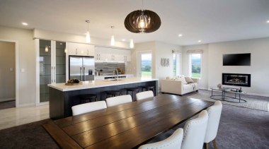 Spacious open plan dining & family rooms surround countertop, interior design, kitchen, property, real estate, room, table, gray