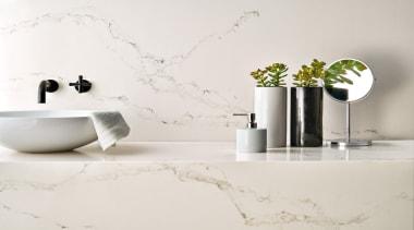 Caesarstone's interpretation of Statuario marble; Statuario Nuvo brings bathroom, ceramic, cup, flowerpot, furniture, interior design, product design, still life photography, table, tap, white