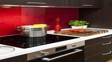 Baumatic ceramic cooktop is a seamless addition to countertop, home appliance, kitchen, kitchen appliance, kitchen stove, small appliance, black, red