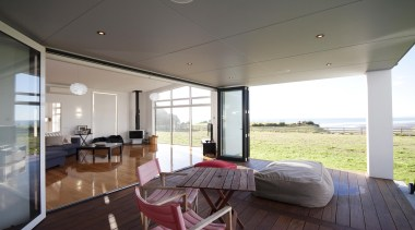 Views over the Taranaki coast are maximised in architecture, ceiling, daylighting, floor, home, house, interior design, living room, property, real estate, window, gray, white