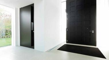 LSQII - Solid Lever Handle on Rose with architecture, door, floor, interior design, property, window, white, black